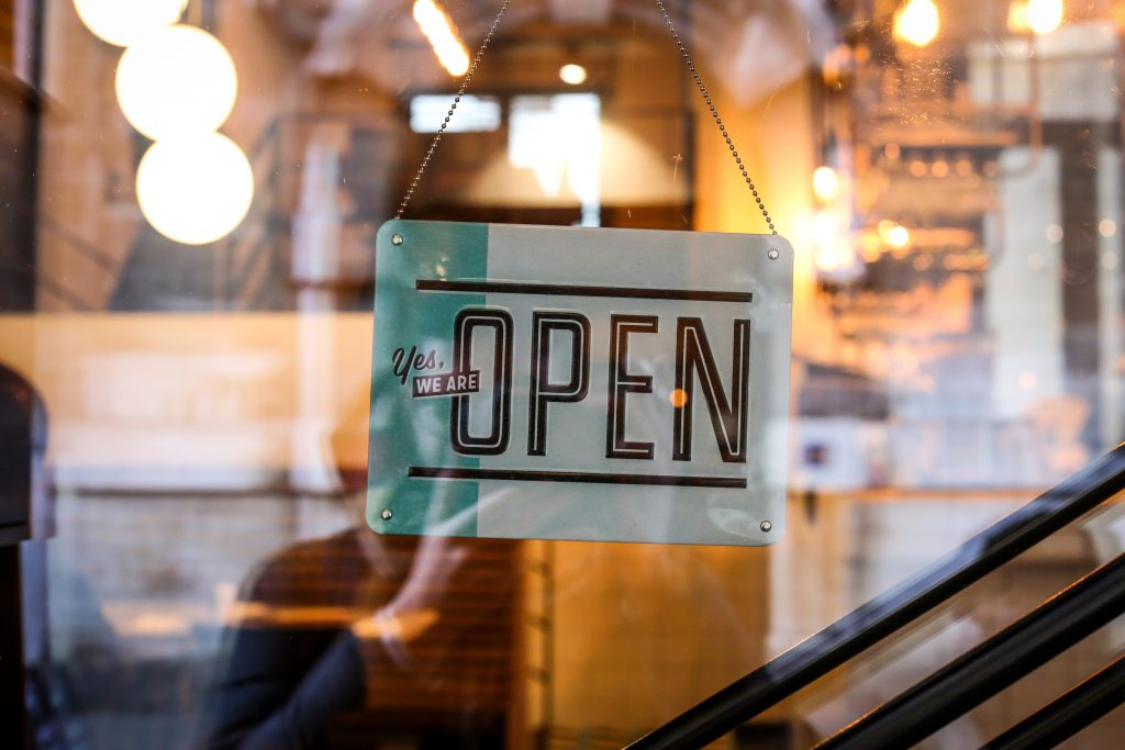 Image by Alexandre Godreau - a shop sign saying 'Open'