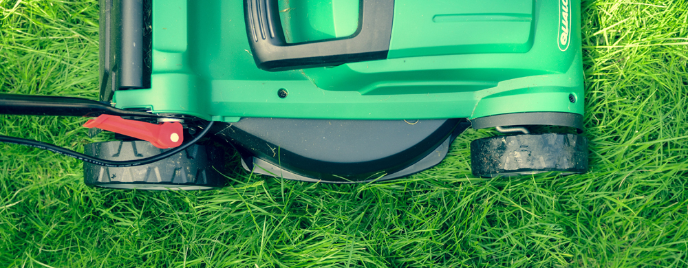 Image by Daniel Watson - a lawnmower cutting grass