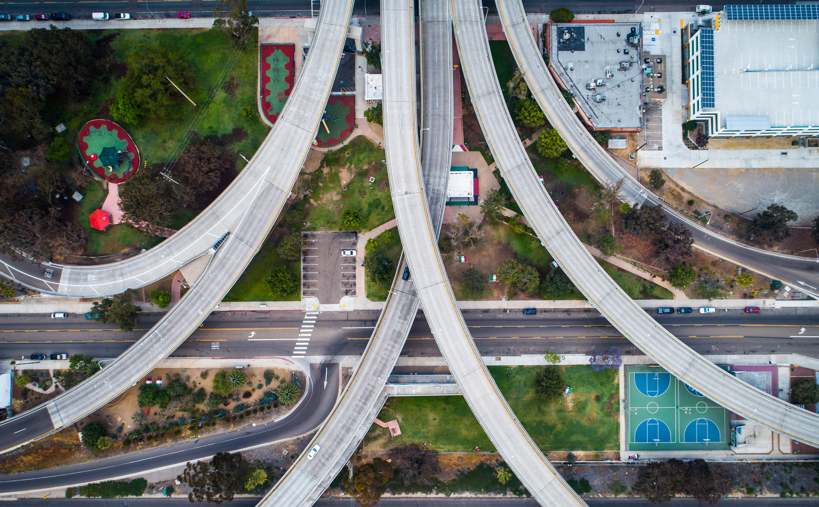 Image by Abraham Barrera - several roads converge into one, aerial view