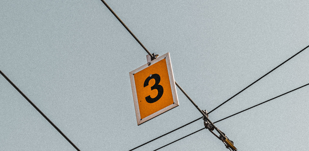 A number 3 hanging from a wire