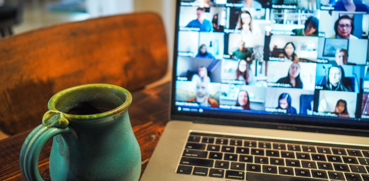 Image by chris Montgomery: a mug next to a laptop showing a Zoom call