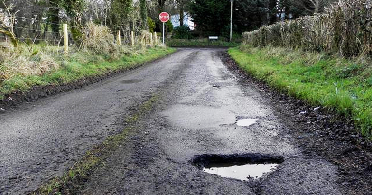 Image of a pothole on a road